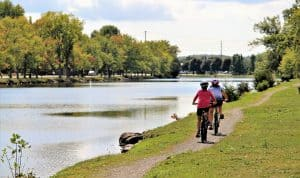 Girls cycling along the Rotary Trail along the Trent Severn Waterway in Campbellford Trent Hills Ontario